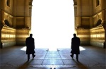 Two Men Walking Towards the Light