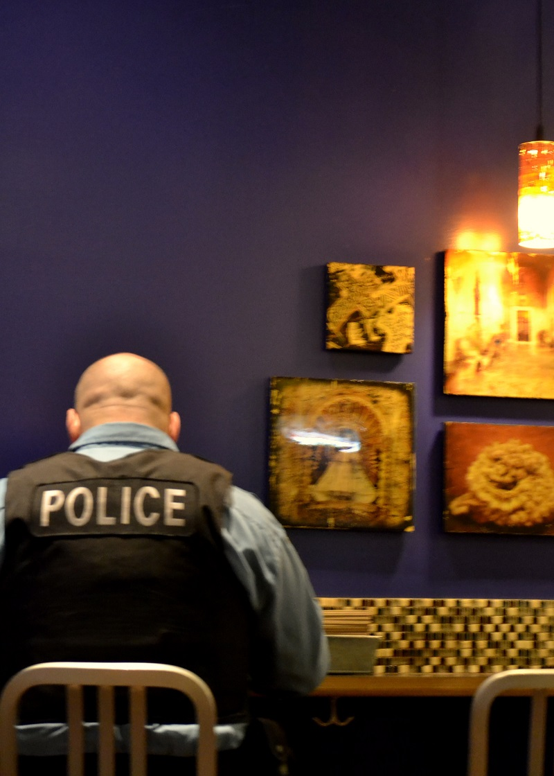 Police Officer at XOCO Restaurant by Rick Bayless