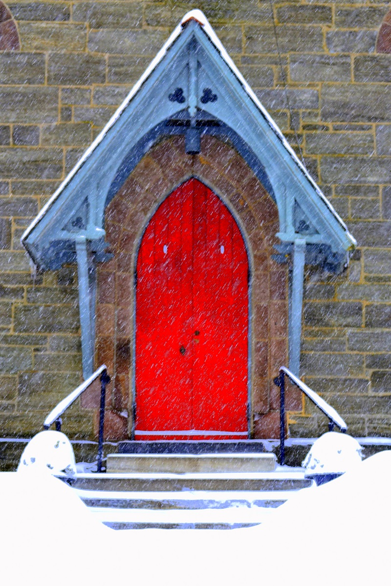 Here, we come upon the door of a church a few blocks from my home. The bright red and blue colors of the door and overhang both seem to pop against the drab, grey surroundings.